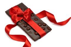 Chocolate con la cinta roja Foto de archivo libre de regalías