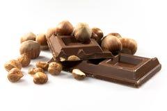 Chocolate con leche con las avellanas Imagen de archivo