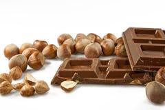 Chocolate con leche con las avellanas Fotos de archivo libres de regalías