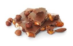 Chocolate con leche delicioso con las nueces fotografía de archivo libre de regalías