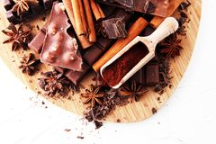 Chocolate concept with assorted chocolate, powder and spices stock image