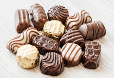Chocolate confectionery. Close up of chocolate confectionery on desk Stock Photos