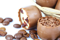 Chocolate confectionery with coffee beans isolated on white Royalty Free Stock Image