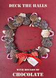 Chocolate cookie Christmas wreath. Chocolate cookie Christmas wreath with candy canes and happy holiday greeting on a rustic red wood table stock images