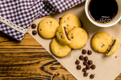 Chocolate Cookie with Coffee Background / Chocolate Cookie with Coffee / Chocolate Cookie with Coffee on Wooden Background Royalty Free Stock Photo