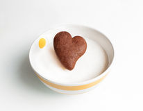 Chocolate cookie heart shaped in white milk Royalty Free Stock Image