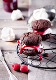 Chocolate cookie with jam and meringue Royalty Free Stock Images