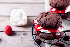 Chocolate cookie with jam and meringue Royalty Free Stock Photo