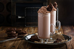 Chocolate cookie milkshake in tall mugs Royalty Free Stock Photos