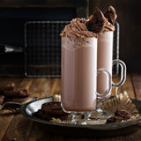 Chocolate cookie milkshake in tall mugs Royalty Free Stock Images