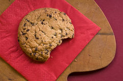 Chocolate cookie over on a cutting board Royalty Free Stock Images