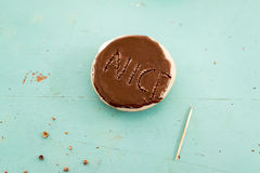 Chocolate cookie with the word Nice on it Stock Photo