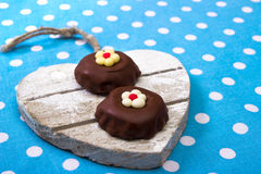 Chocolate cookies. On wooden heart plate Royalty Free Stock Photography