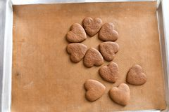 Chocolate cookies on a baking sheet, heart-shaped cookies cooked at home stock photo