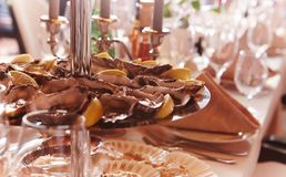 Chocolate cookies on banquet table. Royalty Free Stock Photo