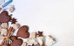 Chocolate cookies, brown sugar, anisetree and cinnamon on white Royalty Free Stock Image
