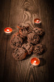 Chocolate cookies with chocolate on a wooden background with candles 1. Chocolate cookies with chocolate on a wooden background with candles Royalty Free Stock Photo