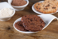 Chocolate cookies with chocolate on wooden background Stock Images