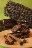 Chocolate Cookies for Christmas. Rustic Holiday Feeling with chocolate cookies, cinnamon sticks and dry fruits Stock Image