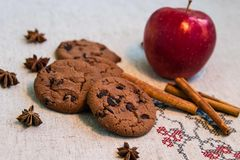 Chocolate cookies with cinnamon, apple and anise stock photos