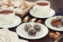 Chocolate cookies with coconut and tea Royalty Free Stock Photos