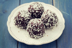 Chocolate cookies with coconut on white plate Stock Photo