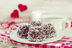 Chocolate cookies with coconut on white plate Royalty Free Stock Photography