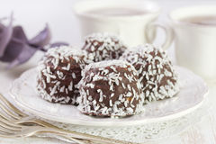 Chocolate cookies with coconut on white plate Stock Photography