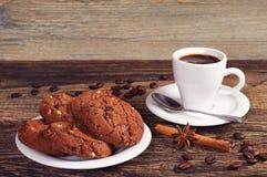 Chocolate cookies and coffee Stock Photos