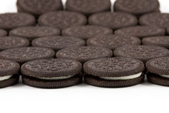 Chocolate cookies with cream filling on white background Royalty Free Stock Image