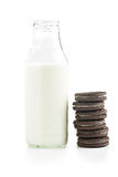 Chocolate cookies with cream and milk Stock Photography