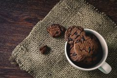 Chocolate cookies in a cup royalty free stock photography