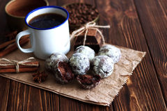 Chocolate cookies and cup of coffee with coffee bean, cocoa powd Royalty Free Stock Photo