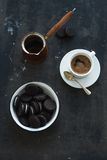 Chocolate cookies with cup and pot of coffee, dark Stock Image