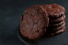 Chocolate cookies on dark background. brownie cookies stack stock photo