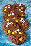 Chocolate cookies decorated with candy eyeballs for Halloween. Holiday Stock Photo