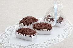 Chocolate cookies in decorative boxes. On a white ornamental table-cloth (napkin royalty free stock image