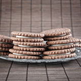 Chocolate cookies filled with white cream Stock Images