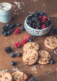 Chocolate cookies with fores berries. On the kitchen, cooking with forest berries,  chocolate, biscuits, and cookies. On the table, waiting for breakfest Stock Photos
