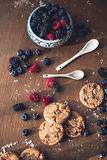 Chocolate cookies with fores berries. On the kitchen, cooking with forest berries,  chocolate, biscuits, and cookies. On the table, waiting for breakfest Stock Photography