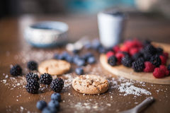 Chocolate cookies with fores berries. On the kitchen, cooking with forest berries,  chocolate, biscuits, and cookies. On the table, waiting for breakfest Royalty Free Stock Photos
