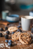 Chocolate cookies with fores berries. On the kitchen, cooking with forest berries,  chocolate, biscuits, and cookies. On the table, waiting for breakfest Royalty Free Stock Images