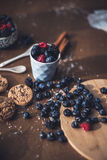 Chocolate cookies with fores berries. On the kitchen, cooking with forest berries,  chocolate, biscuits, and cookies. On the table, waiting for breakfest Royalty Free Stock Photo