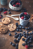 Chocolate cookies with fores berries. On the kitchen, cooking with forest berries,  chocolate, biscuits, and cookies. On the table, waiting for breakfest Royalty Free Stock Photography