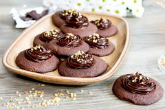 Chocolate cookies with ganache cream and hazelnut Stock Photography