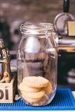 Chocolate cookies in a glass jar on wooden table Royalty Free Stock Image