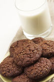Chocolate cookies and a glass of milk Stock Photos