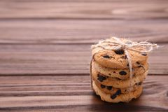 Chocolate cookies on grey table. Chocolate chip cookies shot royalty free stock image