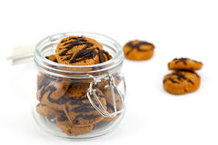 Chocolate Cookies In A Glass Jar Opened On White Stock Photo