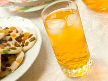 Chocolate cookies and juice glass Stock Photography
